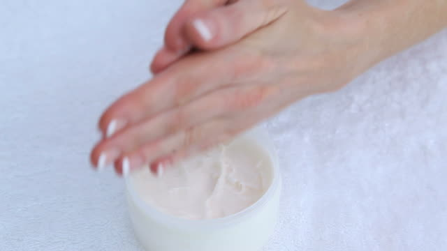 woman moisturising hands - french manicure stock videos and b-roll footage