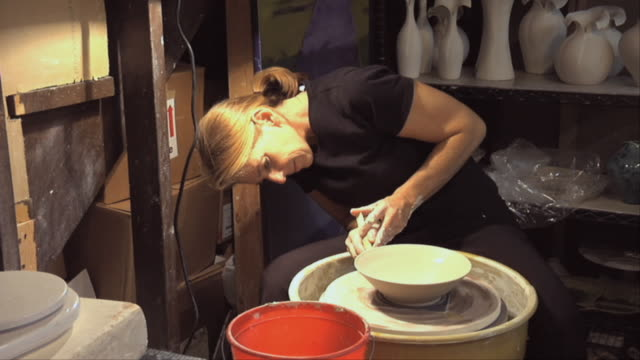 ms zi cu woman molding clay on wheel / naperville, illinois, usa - pottery stock videos and b-roll footage