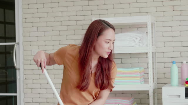woman mopping the floor - sweeping stock videos & royalty-free footage
