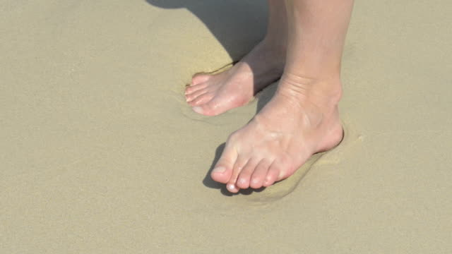 a woman moves her bare feet and toes at beach - toe stock videos & royalty-free footage