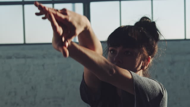 woman moving arms gracefully in ballet studio - bangs stock videos & royalty-free footage