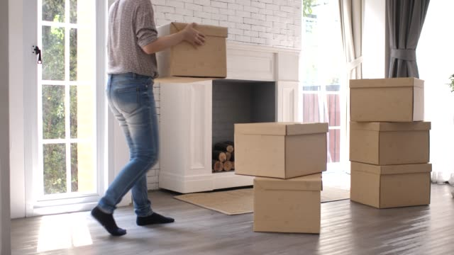 woman moving box to new home - carrying stock videos & royalty-free footage