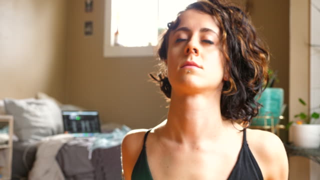 cu woman moving to upward facing dog pose while practicing yoga in bedroom of home - pot plant stock videos and b-roll footage