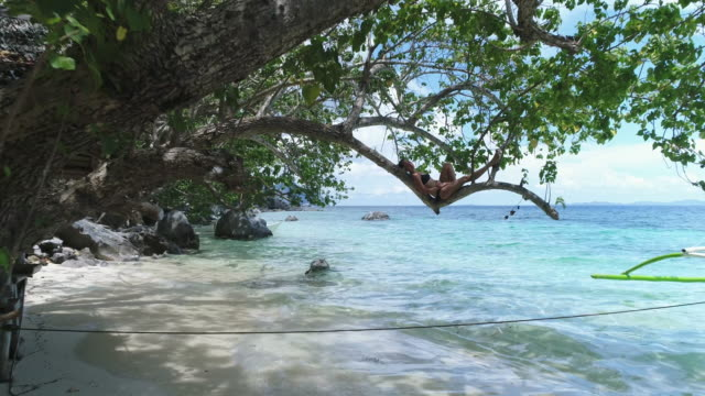 woman napping on branch over water - pacific islanders stock videos & royalty-free footage