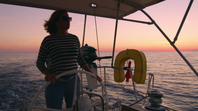 ms woman navigating a sailboat - helm stock videos & royalty-free footage