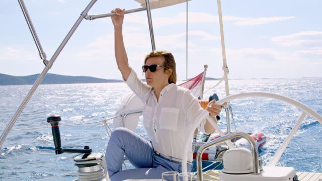 WS Woman navigating a sailboat