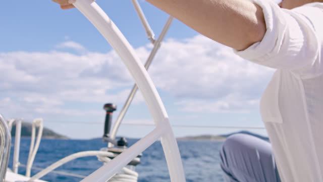 MS LA Woman navigating a sailboat