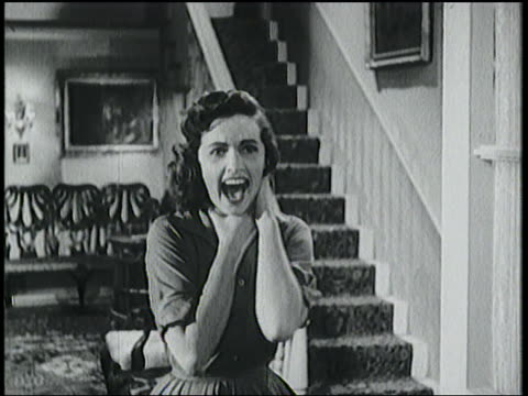 stockvideo's en b-roll-footage met b/w 1958 woman near stairs grabs neck + screams in terror - gillen