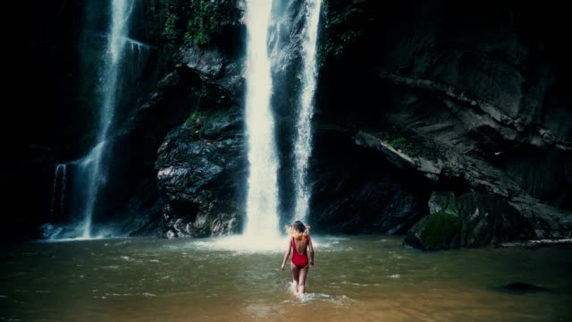 woman near the tropical waterfal - thailand stock videos & royalty-free footage