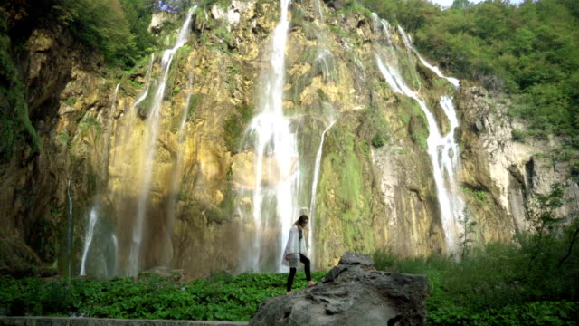 woman near the waterfall - national park stock videos & royalty-free footage