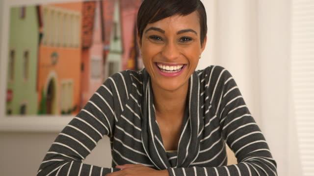 woman nodding and smiling while looking at camera