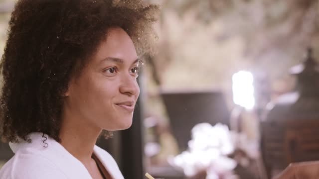woman nodding her head during conversation - nodding head to music stock videos & royalty-free footage