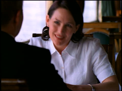 woman nodding to offscreen waiter showing her wine bottle at table in cruise ship restaurant / egypt - paar mittleren alters stock-videos und b-roll-filmmaterial