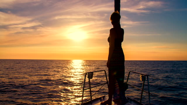 ls woman observing the horizon from a boat - ship's bow stock videos and b-roll footage