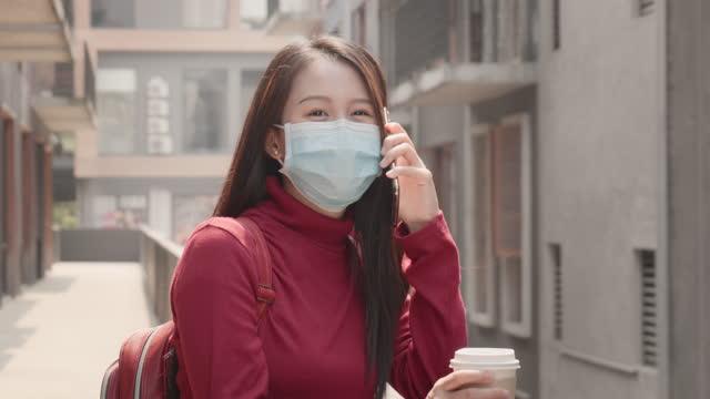 woman of asian descent, aged 20-30 using smart phone - tjänstekvinna bildbanksvideor och videomaterial från bakom kulisserna