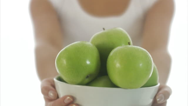 woman offering apples  sweden. - fruit bowl stock videos & royalty-free footage