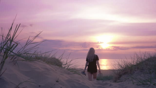 woman on a beach in sunset - swedish culture stock videos & royalty-free footage