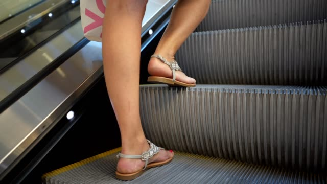 woman on a escalator - rail transportation stock videos & royalty-free footage