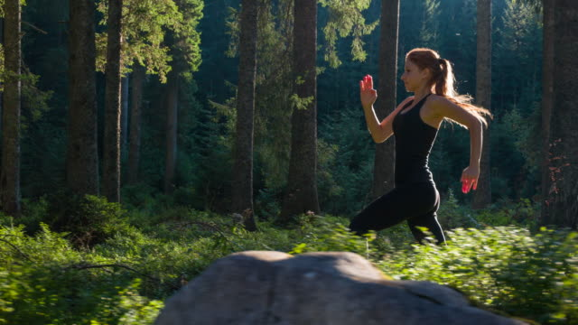 woman on a morning jog - flexibility stock videos & royalty-free footage
