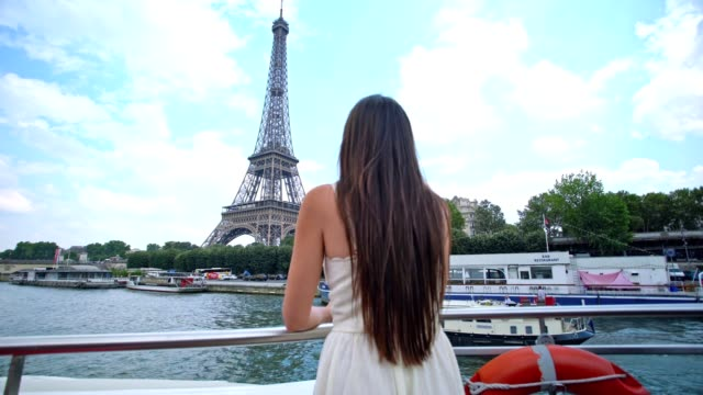 woman on a paris river cruise - eiffel tower stock videos & royalty-free footage