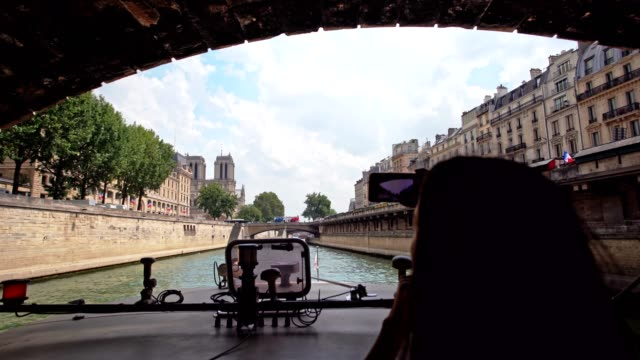 woman on a paris river cruise - river seine stock videos & royalty-free footage