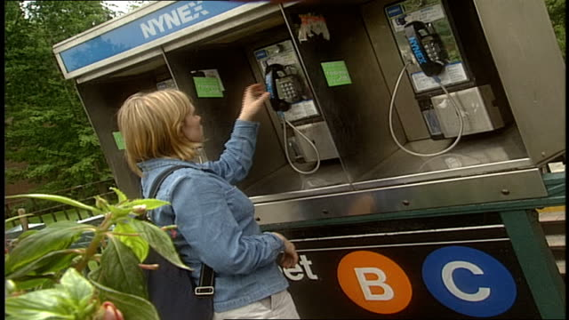 woman on a pay phone in nyc - pay phone stock videos and b-roll footage