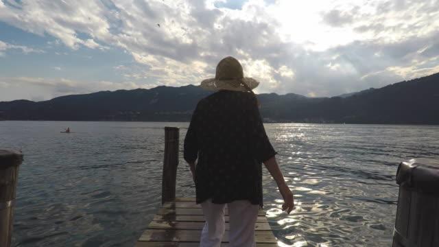 woman on a pontoon, walking - pier stock videos & royalty-free footage