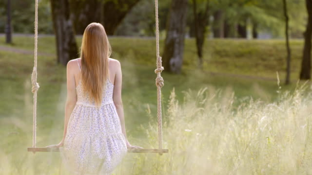 slo mo ds  woman on a swing in nature - dress stock videos and b-roll footage
