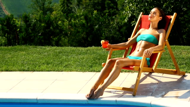 woman on a vacation. - poolside stock videos & royalty-free footage