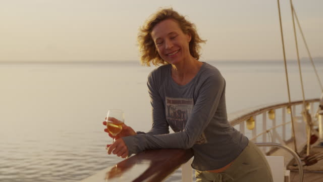 woman on a yacht having a glass of wine - 45 49 years stock videos & royalty-free footage