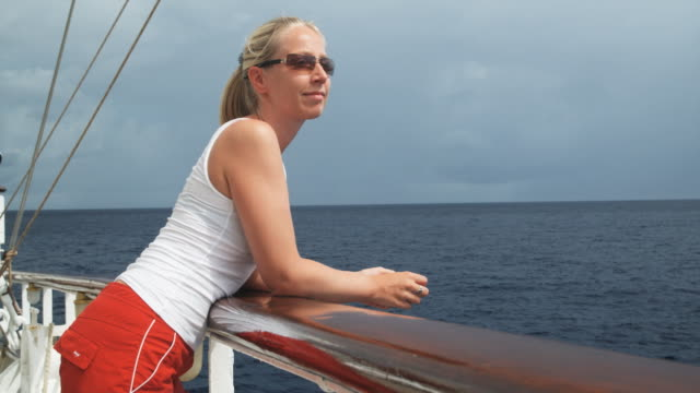 woman on a yacht - three quarter length stock videos & royalty-free footage