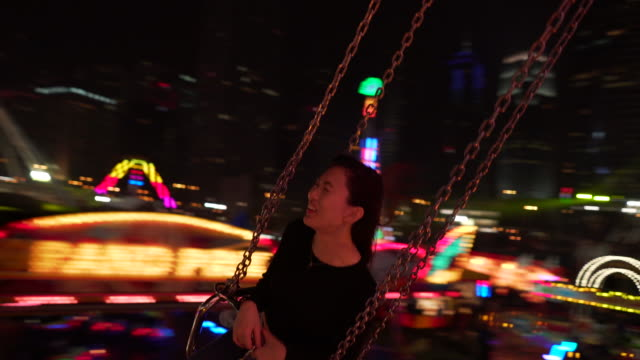 Woman on amusement park ride, POV