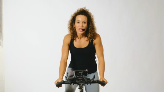 woman on an exercise bike - instructor stock videos & royalty-free footage