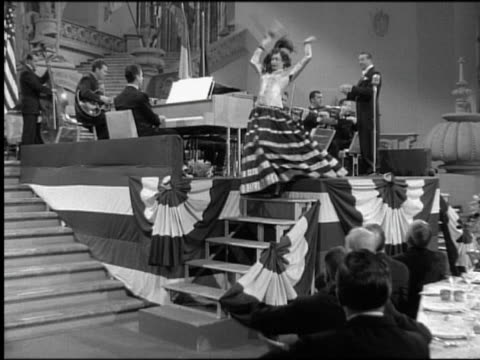 b/w 1949 woman on bandstand walking toward + falling down stairs / band in background / men rush to help - steps and staircases stock videos & royalty-free footage