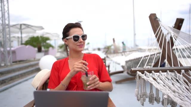 woman on beach hoiday working on laptop - marina stock videos & royalty-free footage