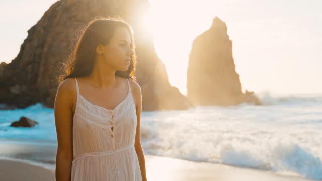 ms pov woman on beach / portugal - white dress stock videos & royalty-free footage
