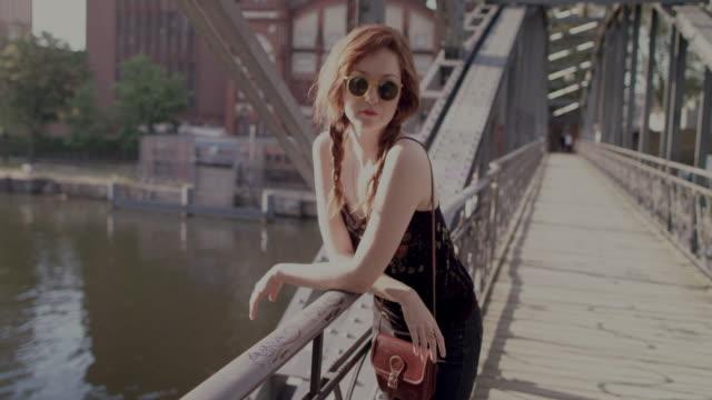 woman on bridge, smiling, enjoying sun - braided hair stock videos & royalty-free footage