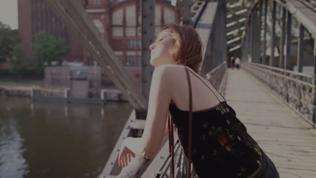 woman on bridge - sonnenbrille stock-videos und b-roll-filmmaterial