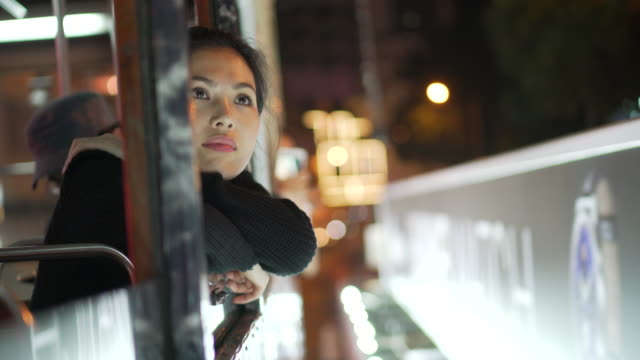 pov, woman on bus in hong kong - top capo di vestiario video stock e b–roll