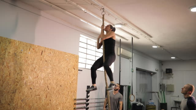woman on climbing rope exercise in gym - rope stock videos & royalty-free footage