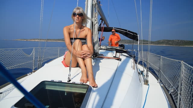 hd: woman on deck of sailing boat - sailing team stock videos & royalty-free footage