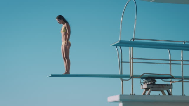 woman on diving board - risk stock videos & royalty-free footage
