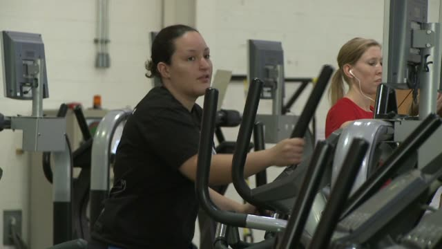 stockvideo's en b-roll-footage met woman on elliptical machine at national institute for fitness and sport on october 06 2013 in indianapolis indiana - ellips