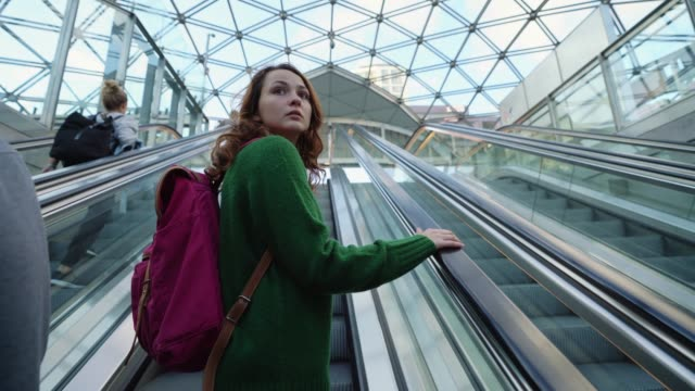 woman on escalator to underground in copenhagen - escalator stock videos & royalty-free footage