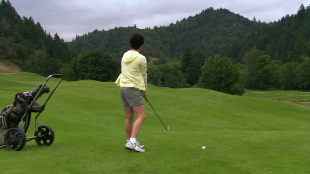 woman on fairway - golf swing stock videos & royalty-free footage