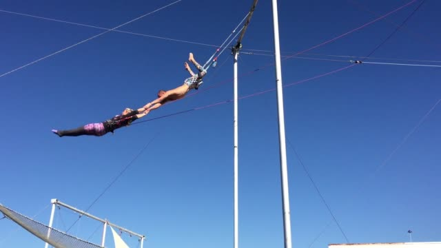 ktla woman on flying trapeze - acrobatic activity stock videos and b-roll footage