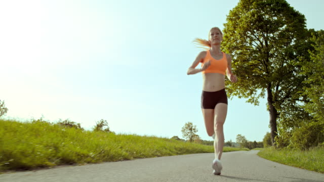 SLO MO TS Woman on her daily run through countryside