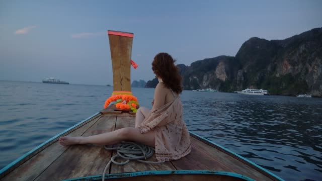 woman on long-tail boat near koh phi phi island - passenger craft stock videos & royalty-free footage