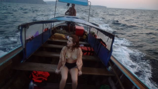 woman on long-tail boat near koh phi phi island - longtail boat stock videos & royalty-free footage