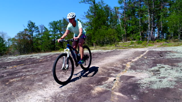 woman on mountain bike - one mature woman only stock videos & royalty-free footage